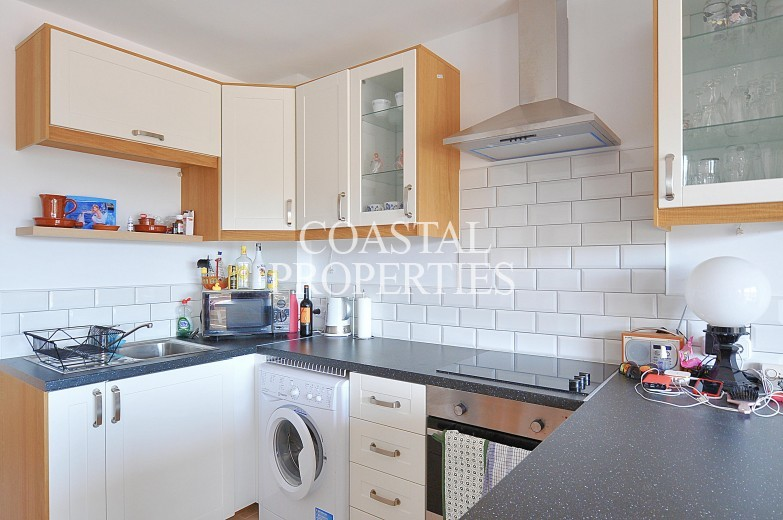 Property for Sale in Apartment with sea views for sale in a popular community close to the beach Son Caliu, Mallorca, Spain